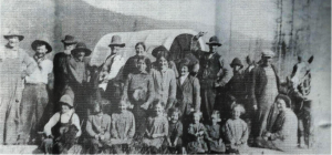 front row: Ivan,  ?,  ?,  Florence, Delva, Gladys, ?,  ? second row:  LaVon, Alta,  ? Back row (by the wagon cover):  Thomas and Julina Lyons